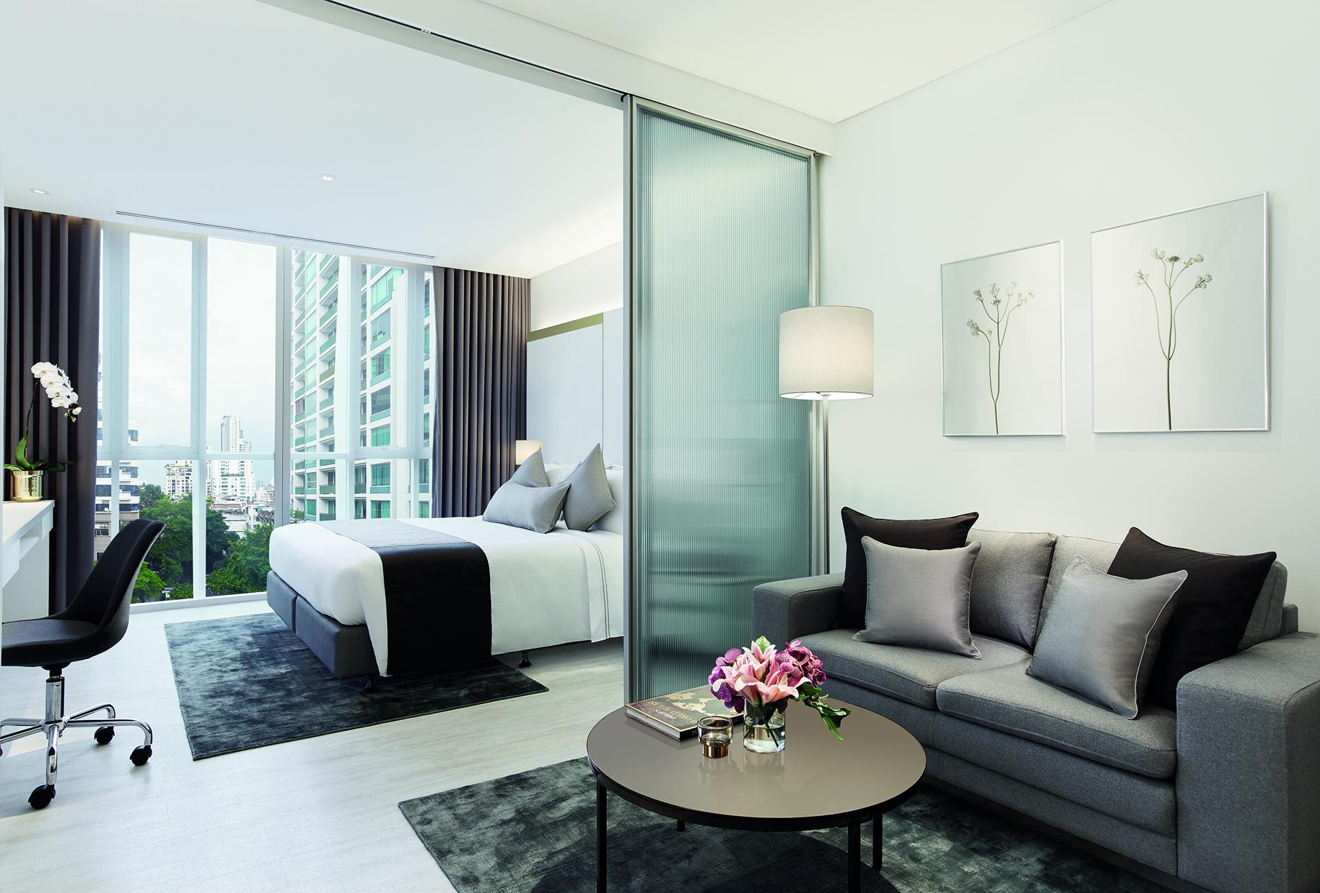 4-ONE-BEDROOM-DELUXE-Bedroom-Living-Area-Hires.jpg